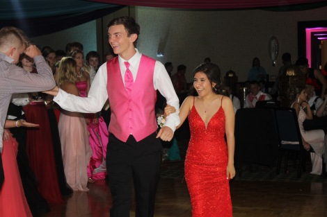 Seniors Reed Plunkett and Samanta Garcia walk across the floor. Photo by Eleni Pappas.