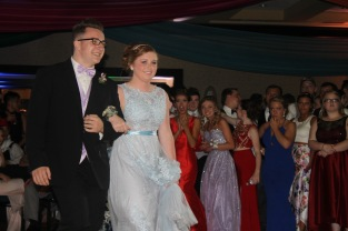 Senior Jacob Mussell escorts senior Gracie Horvath. Photo by Eleni Pappas.