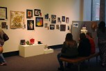 Visitors sit in the art gallery at the Carnegie Center. The NAFCS Secondary Art Show was held there April 15-29.