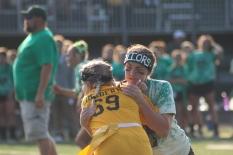 Senior McKenzie Farnsley holds back junior Emma Limeberry on the defense. Photo by Taylor Watt.