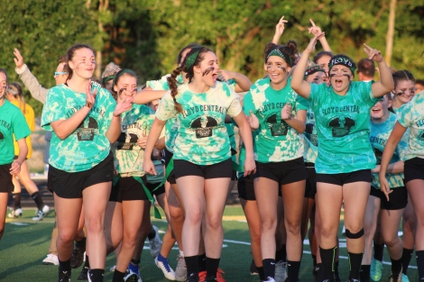Seniors Katie Hopkins, Molly Ottersbach, and the rest of their team celebrate their victory. Photo by Taylor Watt.