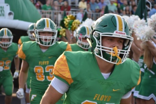 Seniors Braxton Ciquera and Mark Lemme lead the Floyd Central football team onto the field to finally begin the 2017-18 football season. Photo by Tori Roberts.