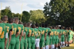 The players of the FC football team line up along the field before the start of the game. The tension is high as the game commences. Photo by Tori Roberts.