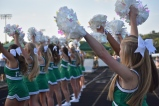 Junior cheerleader, Olivia Taylor, cheers along with the Floyd Central cheerleading squad to hype up the spectators of the game. Photo by Tori Roberts.