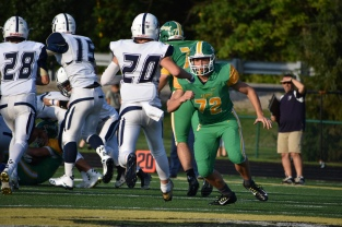 FC senior Reid Suer goes for an offensive block as the play commences. Photo by Tori Roberts.