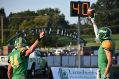 Junior Tyler Edwards and Senior Matt Weimer both celebrate an interception touchdown, bringing Floyd Central even further ahead of Providence in a not-so-close game. Photo by Tori Roberts.