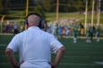 Coach Glesing observes his football team from a distance, ready to catch any mistakes made on a play. For him, winning is the one thing on his mind. Photo by Tori Roberts.