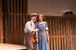 "Senior Mitchell Lewis serenades senior Hannah Nunn in the production of ""Bonnie and Clyde"". Photo by Phoebe Bierman."
