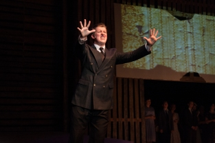 """Senior Bryson Barbee preaches while on stage. """"I've never played a role like this before and I enjoyed challenging myself,"""" says Barbee. Photo by Phoebe Bierman."""
