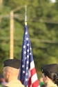Junior Jack Gill holds the flag for the National Anthem to open the game. Photo by Taylor Watt.