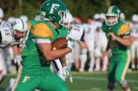 Senior Zach Rodgers sprints the ball advancing to the end zone. Photo by Taylor Watt.