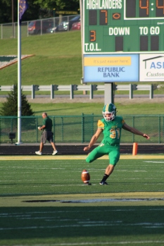 Sophomore Cole Hussung punts the ball to the opposing team. Photo by Taylor Watt.