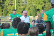 Coach Glesing inspires the team to play their hardest during half time. Photo by Taylor Watt.