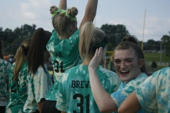 Senior Abby Ahrens cheers on the sidelines as her team scores. Photo by Shelby Pennington.