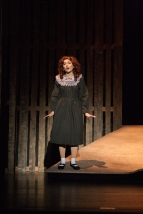 """Sophomore Isabella Arnett plays young Bonnie in the Floyd Central's """"Bonnie and Clyde"""". Photo by Phoebe Bierman."""