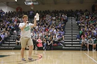 Senior Class president Jacob Rosenbaum introduces the varsity cheerleading team and the Dazzlers.