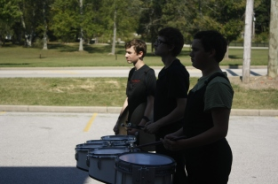 The percussion section from Borden Jr. Sr. High School practices their show during their musical warm up. Each band attending the invitational gets an allotted time in musical and physical warm up before their performance.