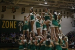 The varsity cheerleading team performs their floor routine.