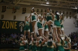 The varsity cheerleading team performs their floor routine.