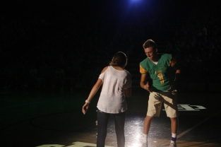 Seniors Matt Weimer and Katie Weimer do a special handshake while walking for homecoming court.