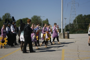 The New Albany High School Bulldog Band moves to their next warm up. The band has 41 total members, which places them in competition Class AA.