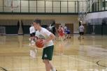 Freshmen Will Bouch runs a layup during practice.