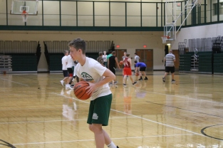 Freshmen Will Bouch runs a layup during practice.
