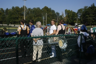 Students from Northeast Dubois High School wait on the sidelines after their performance. Marching band moves quickly; the performing band has mere minutes to clear the field so the next band can set up their show.