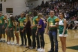 The senior homecoming court lines up on the gym floor.