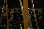 "Senior Libby Sobieski pushes equipment for the Highlander Band, whose show this year is entitled ""Ascension."""