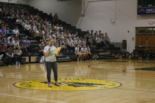 Student Council president Kaylan Caufield announces success in academics and performing arts.