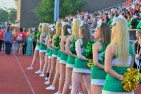 Floyd Central cheerleaders line up and put their hands over their hearts in respect for the American flag. Spectators, players, and staff members alike all rose in recognition as Jeffersonville's ROTC performed a flag ceremony before the beginning of the game. Photo by Tori Roberts.