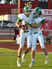 Juniors Bison Pirtle and Tyler Edwards celebrate after another successful touchdown in the first half. By halftime, Floyd Central was still up by 14 with a score of 7-21. Photo by Tori Roberts.