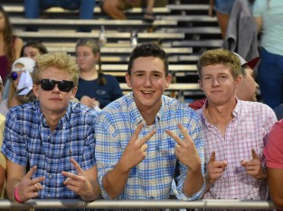 Seniors Gabriel Shireman, Brendan Hobson, and Dillan Zinc pose for a photo during halftime. Floyd, sporting a frat theme, had a great student section turnout. Photo by Tori Roberts.