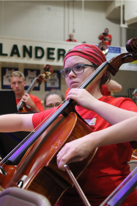 Sophomore Claire Elmore plays her cello during the Symphony Orchestra's performance of Prince's 'Purple Rain.'