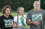 """Last night the girl's soccer team held their senior night game against Jeffersonville. Senior Gabi Brodfehrer took the FC soccer field for the last time, she was escorted by her mother and father across the field. """"This is so hard,"""" she whispered under her breath to one of her underclassmen teammates, while standing on the field. Photo by Sophia Perigo."""