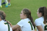Sophomore Celia Dutton tears up as she watches this year's seniors walk on the field for the last time. Photo by Sophia Perigo.