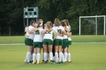 Seniors huddle before their last game before sectionals. Every senior was a starter for last night's game. Photo by Sophia Perigo.