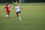 Midfielder and senior Abby May goes for the ball once it bounces after a dropkick from the Jeffersonville keeper. Photo by Sophia Perigo.