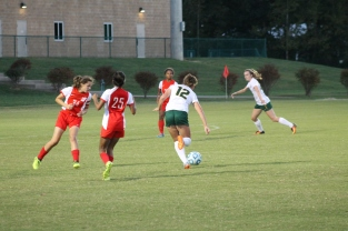 Sophomore Katie Yankey passes the ball to her teammate in hopes of her scoring goal. Photo by Sophia Perigo.