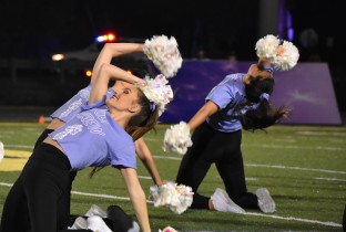 Senior Alyssa Crowl leads the Floyd Central Dazzlers in a stunning halftime performance. The dazzlers boasted purple Kilt Krew shirts in support of the cancer fundraising. Photo by Tori Roberts.