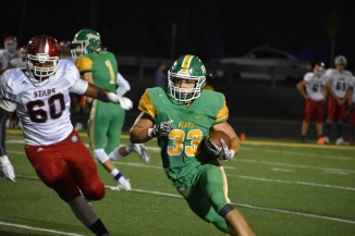 Senior Jason Cundiff runs the ball for yet another touchdown for Floyd. During that third quarter of the game, FC was tied with Bedford at 28. Photo by Tori Roberts.