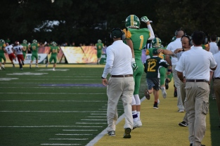 Senior Matt Weimer celebrates with his coaches after a fellow player scores an interception touchdown. FC has scored at least one interception during every home game. Photo by Tori Roberts.