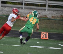Senior Brandon Powell blocks against a Bedford North Lawrence player in the second quarter of the game. At this point, Floyd Central was tied with BNL 14 all. Photo by Tori Roberts.