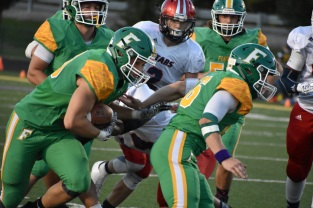 FC players rush the ball during an offensive play. Photo by Tori Roberts.