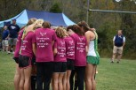 The Superchicks huddle together before they run. The girl's cross country season has gone well so far, and they hoped to do well during sectionals. Photo by Tori Roberts.