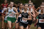 Senior Kyley Sorg keeps her place in the pack as she rounds off the first major turn of the race. Sorg, along with senior Faith Barba, kept a good rank throughout the entirety of the race. Photo by Tori Roberts.