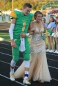 Sophomore Katie Weimer was elected to be the Homecoming representative for the sophomore class. Weimer is walked by her older brother senior Matthew Weimer. Photo by Taylor Watt.