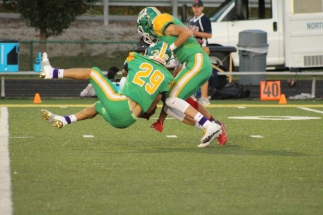 Junior Miles Frazier takes down the opposing player from advancing the ball closer to the end zone. Photo by Taylor Watt.