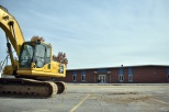 A construction vehicle is seen in front of the new Prosser building. With the facility completed, Prosser students can finally utilize the new building for their education. Photo by Tori Roberts.